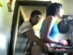 latin boy bangs gal in kitchen