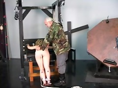 old dominant in camouflage straps his helpless