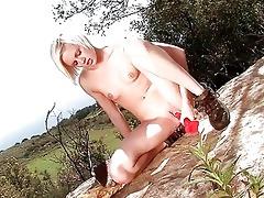 lewd juvenile blond sticks sex-toy up her snatch
