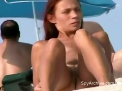 spying on sexy undressed latin babe at the beach
