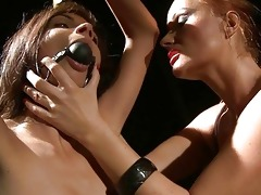 domme punishing young slavegirl
